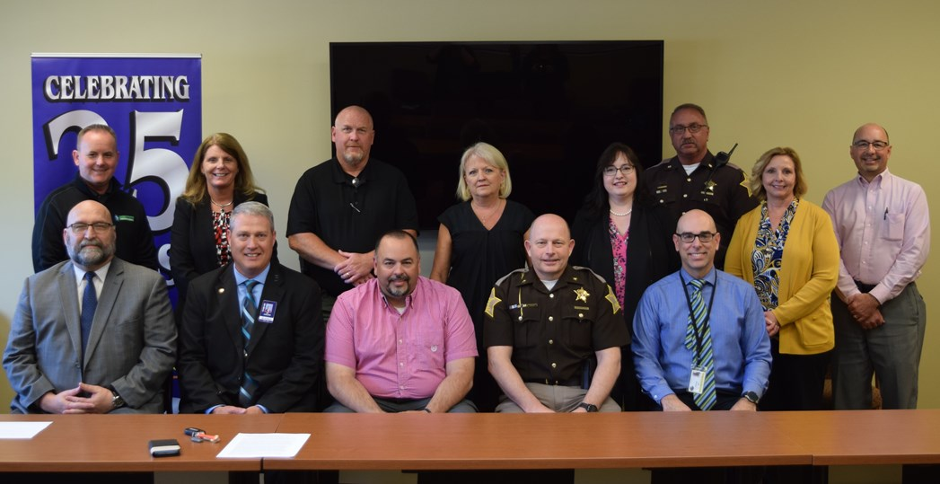 Front row: Jeff Canady, Logansport Jr. High Principal & School Safety Specialist; Dr. Tim Garland, Lewis Cass Superintendent; Chief Rob Smith, Logansport Police; Cass County Sheriff Ed Schroder; Jeff Brooke, Vice Principal, Pioneer High School. Back row: Bill Cuppy, Logansport School Board; Michele Starkey, Logansport Superintendent; Assistant Chief Dan Frye,Logansport Police; President & CEO Deanna Crispen, CCCF; Cass County Prosecutor Lisa Swaim & CCCF Treasurer; Chief Deputy Kevin Pruiett, Cass County Sh